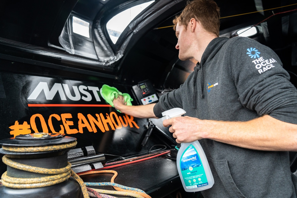 Cullen Zelenka cleans 11th Hour Racing Team IMOCA 60 with Ecoworks Marine cleaning products.