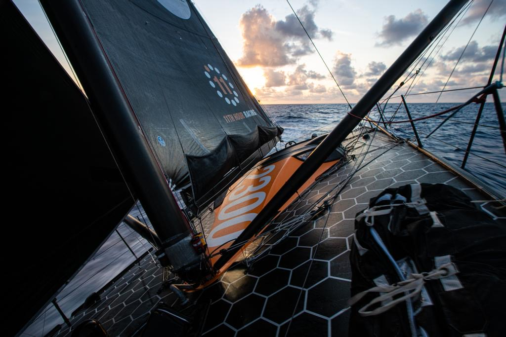 Sunset sailing 11th Hour Racing Team sail Imoca 60 on a transatlantic delivery back to France.
