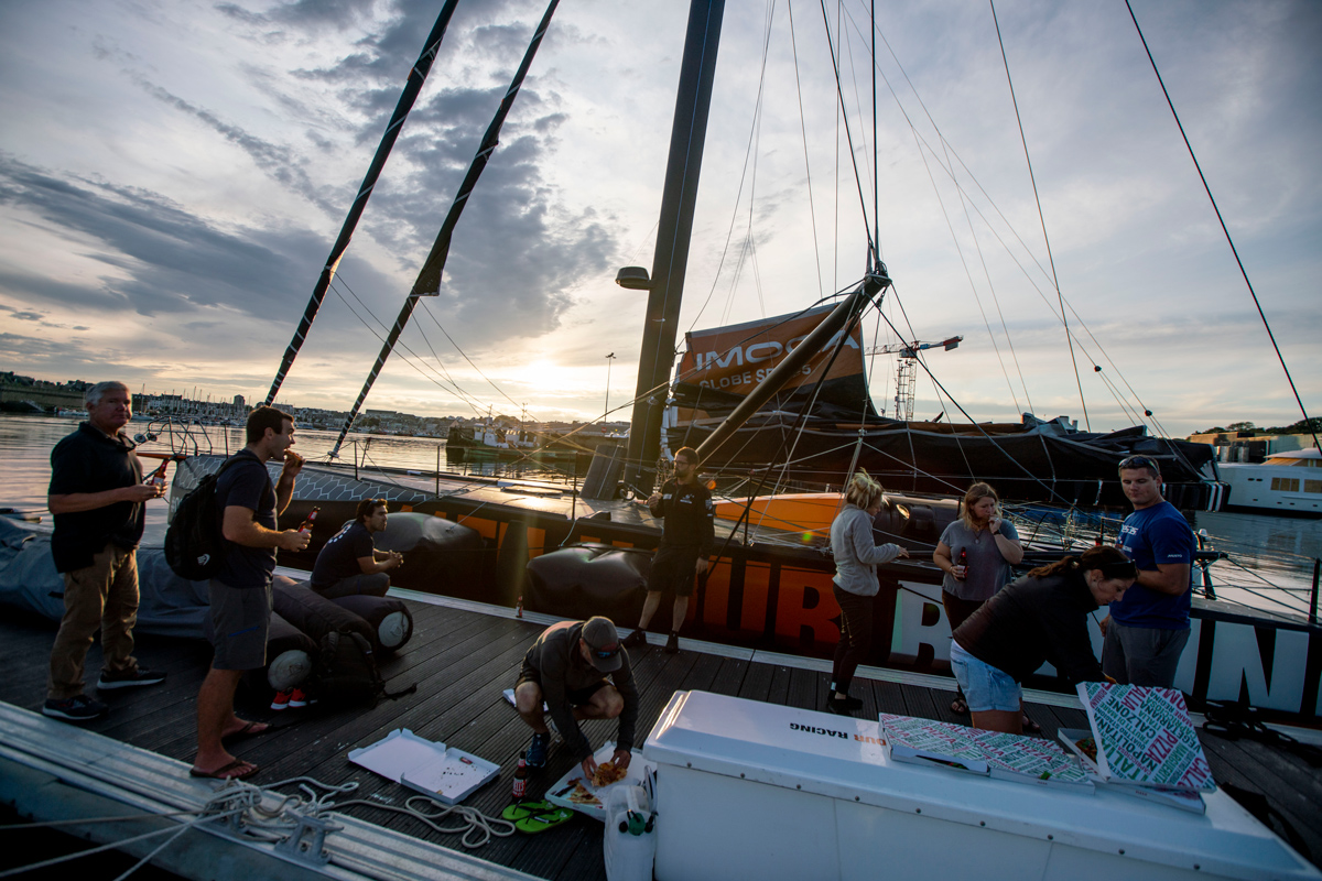 11th hour racing team social hour, gather for pizzas in concarneau france
